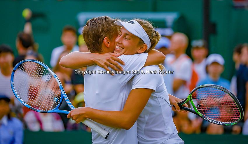 London, England, 5 th. July, 2018, Tennis,  Wimbledon, Women's doubles: Elise Mertens (BEL( and Demi Schuurs (NED) (L) embrace after winning their match<br /> Photo: Henk Koster/tennisimages.com