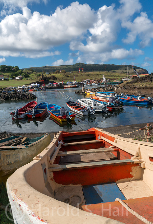 Discovered on Easter 1722, Easter Island is part of Chile.  This volcanic island  is one of the most remote in the world. Its native name is Rapa Nui. Tourists visit for the many moai oversized stone carvings of heads.  However, when the tourists are gone, fishing is a primary means of survival.