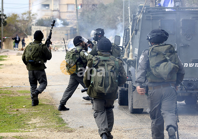Palestinian protesters clash with Israeli soldiers during a demonstration against the expropriation of Palestinian land by Israel in the village of Kfar Qaddum, near the West Bank city of Nablus, on February 24, 2012.  Photo by Wagdi Eshtayah