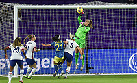 ORLANDO, FL - JANUARY 18: Alyssa Naeher #1of the United States punches a ball out of the box during a game between Colombia and USWNT at Exploria Stadium on January 18, 2021 in Orlando, Florida.