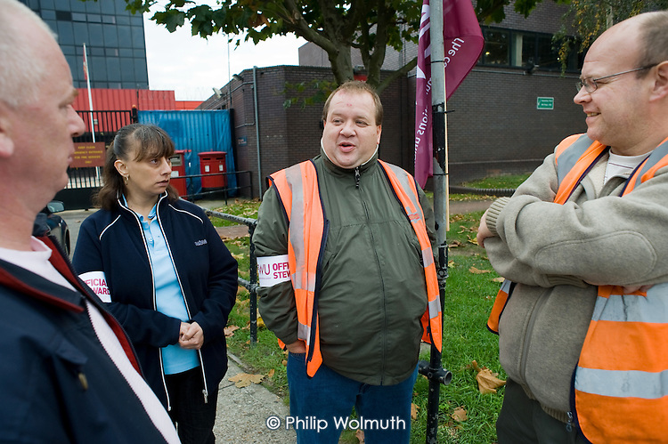 Postal workers picket Royal Mail's Nine Elms mail centre, London, during a national strike by CWU members over wages, conditions and pensions.