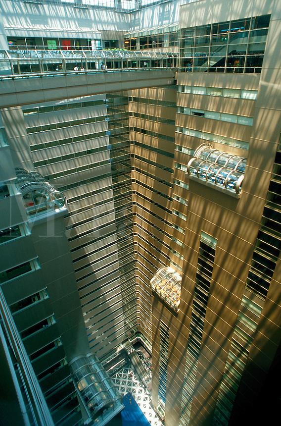 Abstract interior view looking down towards the lobby within the Japanese Shinjuku NS building. Tokyo, Shinjuku district.