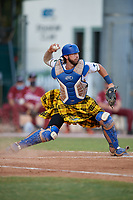 Savannah Bananas catcher Bill Leroy (1) throws down to second base during a Coastal Plain League game against the Macon Bacon on July 15, 2020 at Grayson Stadium in Savannah, Georgia.  Savannah wore kilts for their St. Patrick's Day in July promotion.  (Mike Janes/Four Seam Images)