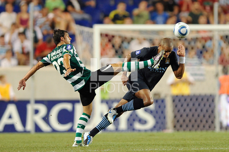 Helder Postiga (23) of Sporting Clube de Portugal is called for a high kick on Vincent Kompany (33) of Manchester City F. C. during a Barclays New York Challenge match between Manchester City F. C. and Sporting Clube de Portugal (Sporting Lisbon) at Red Bull Arena in Harrison, NJ, on July 23, 2010.