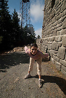 Alex at Stone Tower on Summit of Mt. Constitution, Orcas Island, San Juan Islands, Washington, US