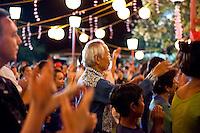 A gathering of community members enjoy the annual obon dance at Lahaina Jodo Buddhist Mission, Lahaina, Maui