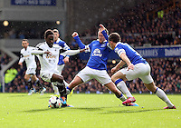 Pictured L-R: Nathan Dyer is tackled by Aiden McGready and Leighton Baines of Everton. Saturday 22 March 2014<br /> Re: Barclay's Premier League, Everton v Swansea City FC at Goodison Park, Liverpool, UK.