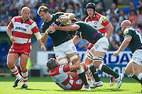 Jon Fisher of London Irish is tackled by Andy Hazell of Gloucester Rugby during the Aviva Premiership match between London Irish and Gloucester Rugby at the Madejski Stadium on Saturday 8th September 2012 (Photo by Rob Munro)