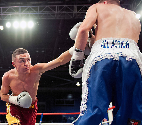 GLASGOW, SCOTLAND - MARCH 10: Jonathan Slowey (red and gold shorts) lands a punch on James Ancliffe (blue and white shorts) during a Super-Bantamweight contest on the Ricky Burns undercard at the Braehead Arena on March 10, 2012 in Glasgow, Scotland. (Photo by Rob Casey/Getty Images)