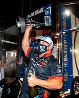 Nov 1, 2020; Las Vegas, Nevada, USA; NHRA funny car driver Matt Hagan celebrates after clinching the 2020 NHRA funny car World Championship during the NHRA Finals at The Strip at Las Vegas Motor Speedway. Mandatory Credit: Mark J. Rebilas-USA TODAY Sports