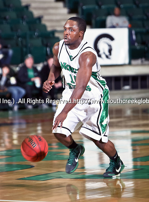 North Texas Mean Green guard Josh White (10) brings the ball down court in the game between the Texas State Bobcats and the University of North Texas Mean Green at the North Texas Coliseum,the Super Pit, in Denton, Texas. UNT defeated Texas State 85 to 62