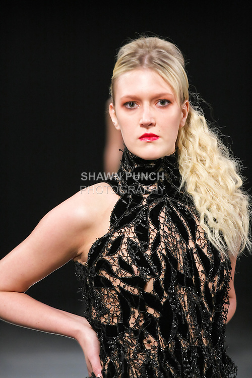 Model walks the runway in an outfit by Jamil Khansa, during Couture Fashion Week Fall 2011.