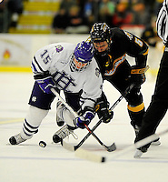 29 December 2007: Holy Cross Crusaders' forward Chris Trovato, a Senior from North Attleboro, MA, battles University of Vermont Catamounts' forward Brayden Irwin, a Sophomore from Toronto, Ontario, during a game at Gutterson Fieldhouse in Burlington, Vermont. The Catamounts rallied in the final seconds of play to tie the game 1-1. After overtime, although the official result remained a tie game, the Cats moved up to the championship round by winning a sudden death shootout in the second game of the Sheraton/TD Banknorth Catamount Cup Tournament...Mandatory Photo Credit: Ed Wolfstein Photo