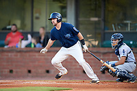 Mobile BayBears first baseman Zach Houchins (8) follows through on a swing in front of catcher Adrian Nieto (17) during a game against the Pensacola Blue Wahoos on April 25, 2017 at Hank Aaron Stadium in Mobile, Alabama.  Mobile defeated Pensacola 3-0.  (Mike Janes/Four Seam Images)