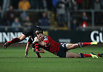Scrum-half Cathal Sheridan of Munster Rugby tackles Inside centre Ashley Smith of Newport Gwent Dragons.<br /> <br /> Guinness Pro 12<br /> Newport Gwent Dragons v Munster Rugby<br /> Rodney Parade<br /> 21.11.14<br /> ©Steve Pope-SPORTINGWALES