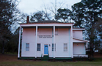 Georgiana Alabama Hank Williams Sr Fan Club House in hometown with large white home in small town music legend