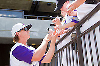 Joe Serafin #9 of the Winston-Salem Dash signs autographs for young fans prior to the Carolina League game against the Wilmington Blue Rocks at BB&T Ballpark on April 24, 2011 in Winston-Salem, North Carolina.   Photo by Brian Westerholt / Four Seam Images