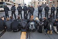 """Mehrere hundert Menschen protestierten am Freitag den 17. Juni 2016 in Berlin egegen einen Marsch von knapp 100 Rechtsextreme der sog. """"Identitaeren"""". Die Polizei sperrte die Route des rechtsextremen Aufmarsches ab und entfernte immer wieder einzelne Personen aus dem Bereich. Dennoch gelang es einigen Menschen die Strecke mit einer Sitzblockade zu blockieren. Die Rechten mussten daraufhin ihren Aufmarsch vorzeitig beenden.<br /> 17.6.2016, Berlin<br /> Copyright: Christian-Ditsch.de<br /> [Inhaltsveraendernde Manipulation des Fotos nur nach ausdruecklicher Genehmigung des Fotografen. Vereinbarungen ueber Abtretung von Persoenlichkeitsrechten/Model Release der abgebildeten Person/Personen liegen nicht vor. NO MODEL RELEASE! Nur fuer Redaktionelle Zwecke. Don't publish without copyright Christian-Ditsch.de, Veroeffentlichung nur mit Fotografennennung, sowie gegen Honorar, MwSt. und Beleg. Konto: I N G - D i B a, IBAN DE58500105175400192269, BIC INGDDEFFXXX, Kontakt: post@christian-ditsch.de<br /> Bei der Bearbeitung der Dateiinformationen darf die Urheberkennzeichnung in den EXIF- und  IPTC-Daten nicht entfernt werden, diese sind in digitalen Medien nach §95c UrhG rechtlich geschuetzt. Der Urhebervermerk wird gemaess §13 UrhG verlangt.]"""