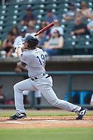 Alex Kirilloff (19) of the Pensacola Blue Wahoos follows through on his swing against the Birmingham Barons at Regions Field on July 7, 2019 in Birmingham, Alabama. The Barons defeated the Blue Wahoos 6-5 in 10 innings. (Brian Westerholt/Four Seam Images)