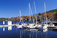 marina, Sunapee, NH, New Hampshire, Sailboats moored at a dock on the calm waters of Lake Sunapee in Sunapee in the autumn.