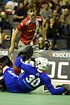Berlin, Germany, January 31: Victor Aly #30 of Rot-Weiss Koeln makes a save against Constantin Staib #11 of Club an der Alster during the 1. Bundesliga Herren Hallensaison 2014/15 semi-final hockey match between Rot-Weiss Koeln (dark blue) and Club an der Alster (red) on January 31, 2015 at the Final Four tournament at Max-Schmeling-Halle in Berlin, Germany. Final score 4-3 (2-2). (Photo by Dirk Markgraf / www.265-images.com) *** Local caption ***
