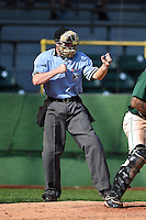 Umpire Ryan Doherty makes a call during a game between the Beloit Snappers and Clinton LumberKings on August 17, 2014 at Ashford University Field in Clinton, Iowa.  Clinton defeated Beloit 4-3.  (Mike Janes/Four Seam Images)