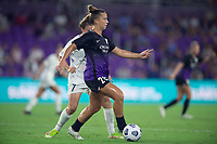 ORLANDO, FL - SEPTEMBER 11: Meggie Dougherty Howard #28 of the Orlando Pride dribbles the ball during a game between Racing Louisville FC and Orlando Pride at Exploria Stadium on September 11, 2021 in Orlando, Florida.