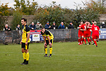 Hucknall Town Captain Aaron Short is dejected as  Lewis Weaver of Heanor Town celebrates after scoring the only goal of the game in the 80th minute. Hucknall Town v Heanor Town, 17th October 2020, at the Watnall Road Ground, East Midlands Counties League. Photo by Paul Thompson.
