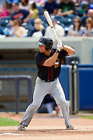 Joe Sclafani (9) of the Quad Cities River Bandits at bat against the West Michigan Whitecaps at Fifth Third Ballpark on May 5, 2013 in Comstock Park, Michigan.  The River Bandits defeated the Whitecaps 5-4.  (Brian Westerholt/Four Seam Images)