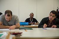 Sprachunterricht fuer Fluechtlinge bei der Handwerkskammer in Cottbus.<br /> In Zusammenarbeit mit dem regionalen Jobcenter, Fluechtlingshilfen und zustaendigen Behoerden versucht die Handwerkskammer Fluechtlingen eine Perspektive fuer Fluechtlinge zu schaffen. Zwischen bis zu 20 Fluechtlinge aus Eritrea, Afgahnistan, Syrien und xxx lernen hier Deutsch und bekommen die Moeglichkeit sich ueber die ausserbetrieblichen Ausbildungsmoeglichkeiten zu informieren oder bei Firmenbesuchen einen Ausbildungsplatz suchen.<br /> Entstanden ist diese Initiative der Handwerkskammer Cottbus aufgrund der geringen Zahl an Auszubildenden. Zu viele junge Menschen verlassen die Region. Dies bereitet den Handwerksbetrieben grosse Probleme.<br /> Im Bild hinten: Der Fluechtling Aynalem aus Eritrea.<br /> Im Bild vorne: Die Fluechtlinge Mohammad aus Afghanistan und Mahmoud aus Syrien.<br /> 11.11.2015, Cottbus<br /> Copyright: Christian-Ditsch.de<br /> [Inhaltsveraendernde Manipulation des Fotos nur nach ausdruecklicher Genehmigung des Fotografen. Vereinbarungen ueber Abtretung von Persoenlichkeitsrechten/Model Release der abgebildeten Person/Personen liegen nicht vor. NO MODEL RELEASE! Nur fuer Redaktionelle Zwecke. Don't publish without copyright Christian-Ditsch.de, Veroeffentlichung nur mit Fotografennennung, sowie gegen Honorar, MwSt. und Beleg. Konto: I N G - D i B a, IBAN DE58500105175400192269, BIC INGDDEFFXXX, Kontakt: post@christian-ditsch.de<br /> Bei der Bearbeitung der Dateiinformationen darf die Urheberkennzeichnung in den EXIF- und  IPTC-Daten nicht entfernt werden, diese sind in digitalen Medien nach §95c UrhG rechtlich geschuetzt. Der Urhebervermerk wird gemaess §13 UrhG verlangt.]