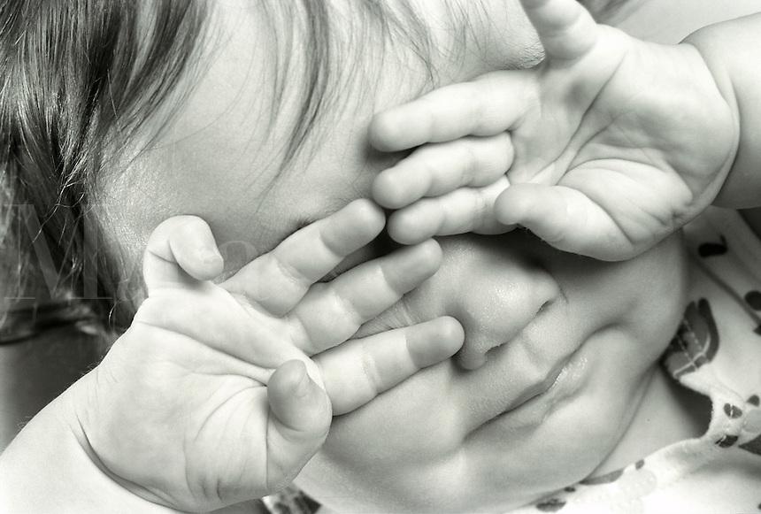 baby girl crying,rubbing eyes