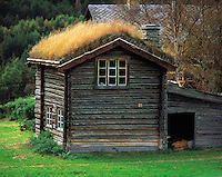 Strongly-built turf-roofed timber outhouse at Dovre near Dombas, Norway