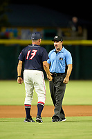 Jacksonville Jumbo Shrimp manager Al Pedrique (13) questions a call with umpire Tom West during a game against the Memphis Redbirds on September 25, 2021 at 121 Financial Ballpark in Jacksonville, Florida.  (Mike Janes/Four Seam Images)