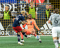 FOXBOROUGH, MA - SEPTEMBER 23: Diego Fagundez #14 of New England Revolution scores during a game between Montreal Impact and New England Revolution at Gillette Stadium on September 23, 2020 in Foxborough, Massachusetts.