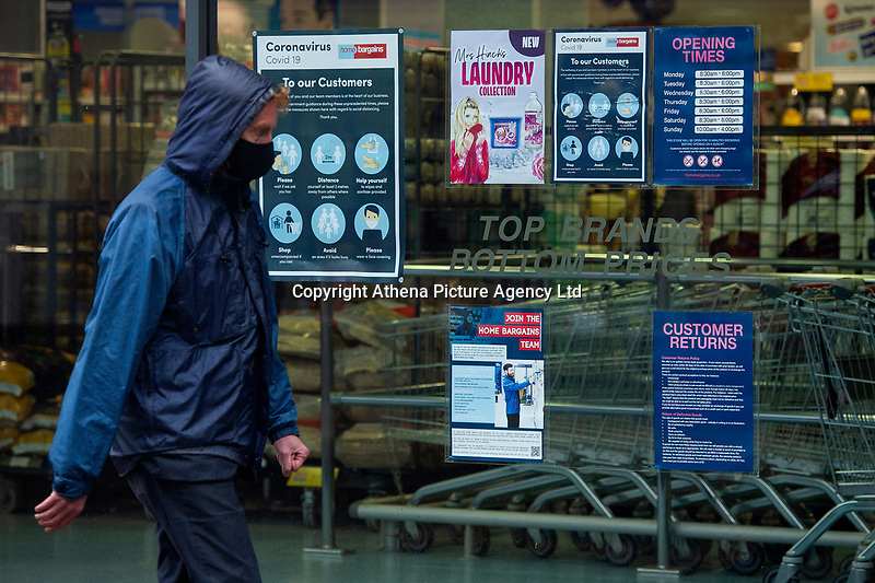 Pictured: A man walks through Llanelli Town Centre, Llanelli, Wales, UK. Sunday 27 September 2020<br /> Re: Local lockdown will be in force from 6pm on the 27th of September, due to the Covid-19 Coronavirus pandemic, in Llanelli, Wales, UK