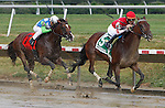 10 July 2010: Pickapocket, Brian Hernandez Jr. up, passes pacesetter Nicanor on his way to winning the Sussex Stakes at Delaware Park, Stanton, DE. Nicanor, Jose Valdivia Jr. up, finished third after being passed by Bullsbay just before the finish.