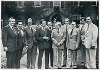 After a lunch break; nine premiers and a deputy line up outside hall on York University's Glendon campus. From left: Premiers William Davis of Ontario; Dave Barrett of B.C.; Frank Moores of Newfoundland and Robert Bourassa of Quebec; Deputy Premier Peter Nicholson of Nova Scotia; Premiers Peter lougheed of Alberta; Richard Hatfield of New Brunswick; Allan Blankeney of Saskatchewan; Ed Schreyer of Manitoba and Alex Campbell of Prince Edward Island. They had just had their shoes shined by students raising money of cystic fibrosis research.<br /> <br /> 1974<br /> <br /> PHOTO :  Doug Griffin - Toronto Star Archives - AQP