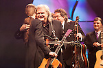 September 26, 2013. Raleigh, North Carolina.<br />  After being inducted the International Bluegrass Music Hall of Fame, Tony Rice, left, played a short set, and was then hugged by Ricky Skaggs.<br />  Bluegrass guitar legend Tony Rice was inducted into the International Bluegrass Music Hall of Fame during the International Bluegrass Music Awards, held in Memorial Hall at the Duke Energy Center for the Performing Arts.