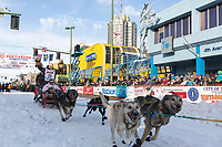 Jeff King and team leave the ceremonial start line with an Iditarider at 4th Avenue and D street in downtown Anchorage, Alaska on Saturday March 2nd during the 2019 Iditarod race. Photo by Brendan Smith/SchultzPhoto.com