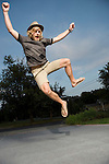 USA, Illinois, Peoria, Young man jumping and cheering