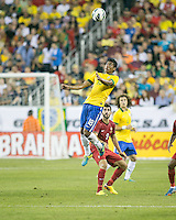 Brazil midfielder Paulinho (18) leaps intercept a head ball as Portugal forward Nelson Oliveira (9) stands by.  In an International friendly match Brazil defeated Portugal, 3-1, at Gillette Stadium on Sep 10, 2013.