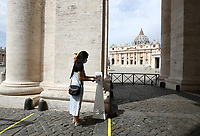 xtA woman cleans her hands before entering in St. Peter's Square and Basilica on May 18, 2020 at The Vatican  in the day of the reopening of St. Peter's Basilica. Italy is slowly lifting sanitary restrictions after a two-month coronavirus lockdown.<br /> UPDATE IMAGES PRESS/Isabella Bonotto<br /> <br /> STRICTLY ONLY FOR EDITORIAL USE