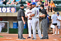 First base umpire Lance Seilhamer,  Greeneville Astros manager Danny Ortega (53), Kingsport Mets manager Luis Rivera (9) and home plate umpire Brandon Blome exchange lineup cards before a game between the Kingsport Mets and the Greeneville Astros at Pioneer Park on July 1, 2017 in Greeneville, Tennessee. The Astros defeated the Mets 6-2. (Tony Farlow/Four Seam Images)