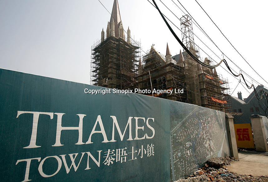 Construction site of the exclusive Thames Town Villas development in Shanghai, China. A villa in Thames Town cost an average of 400,000 euros, while a worker earns less than 3 euros a day. Such disparities between the rich and poor have driven the ongoing National People's Congress meeting to delay the voting of a key legislation that is suppose to protect the ownership of private property..10 Mar 2006