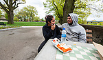 WATERBURY, CT 051021JS05—Waterbury residents Ananalisse Cruz and Thomas DuPre enjoy lunch in the newly renovated Library Park in Waterbury on Monday.  <br /> Jim Shannon Republican American