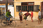 Men playing Chinlon with a woven rattan ball at the end of a days work. A circle is formed and the ball must be kept aloft using various parts of the body but not the hands.    (formally known as Maymyo Burma.) 2006