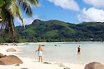 Seychelles, Island Mahe, Anse Boileau: couple at beach, west coast<br />