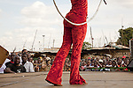 Sarakasi Acrobats performing for a crowd in Kibera as part of monthly Wapi event.