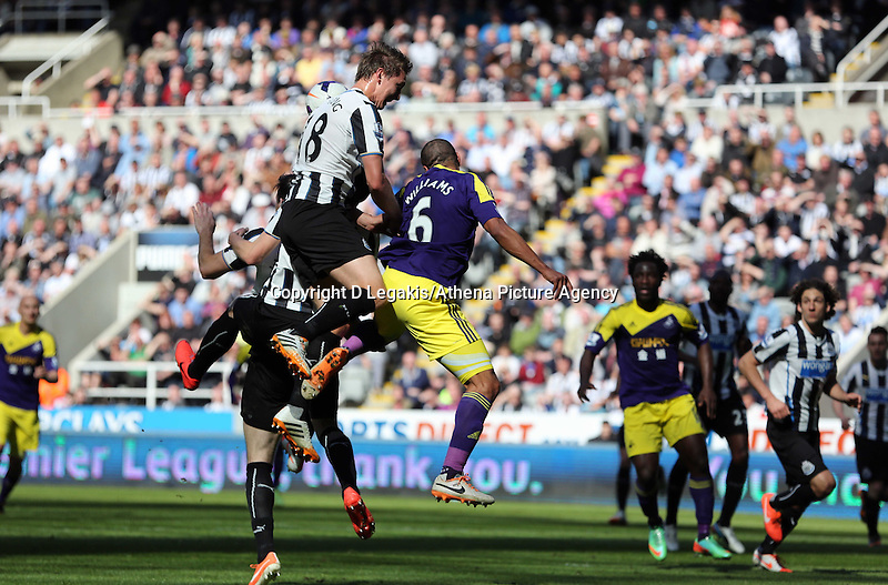 Pictured: Ashley Williams of Swansea (C) has his header challenged by Luuk de Jong of Newcastle. Saturday 19 April 2014<br /> Re: Barclay's Premier League, Newcastle United v Swansea City FC at St James Park, Newcastle, UK.
