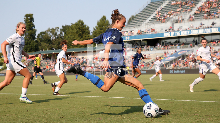 CARY, NC - SEPTEMBER 12: Havana Solaun #19 of the North Carolina Courage crosses the ball during a game between Portland Thorns FC and North Carolina Courage at Sahlen's Stadium at WakeMed Soccer Park on September 12, 2021 in Cary, North Carolina.